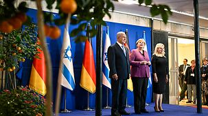 Chancellor Angela Merkel is welcomed to the German-Israeli government consultations by Israel's Prime Minister Benjamin Netanyahu.