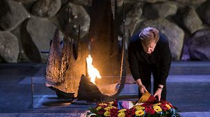 Chancellor Angela Merkel lays a wreath during her visit to the Yad Vashem World Holocaust Remembrance Center.