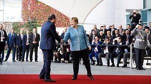 Chancellor Angela Merkel greets Egyptian President Abdel Fattah al-Sisi at the Federal Chancellery.