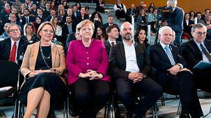 ChancellorAngela Merkel at the award ceremony for the National Integration Prize next to award-winner Gal Rachman