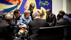 Chancellor Angela Merkel in discussion with Paul Kagame, President of Rwanda, and other African leaders