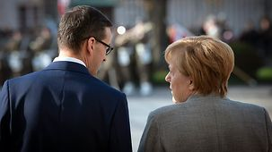 Chancellor Angela Merkel with Mateusz Morawiecki, Polish Prime Minister, during the welcome with military honours