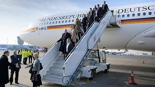 Cabinet ministers and ministry representatives alight from the plane in Warsaw.