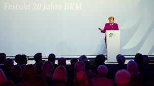 Chancellor Angela Merkel speaks at the ceremony to mark the 20th anniversary of the first appointment of a federal government commissioner for culture and the media.