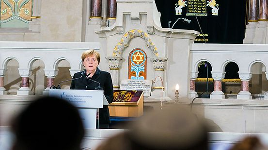 Chancellor Angela Merkel speaks at the central ceremony organised by the Central Council of Jews in Germany in the synagogue in Berlin's Rykestrasse.