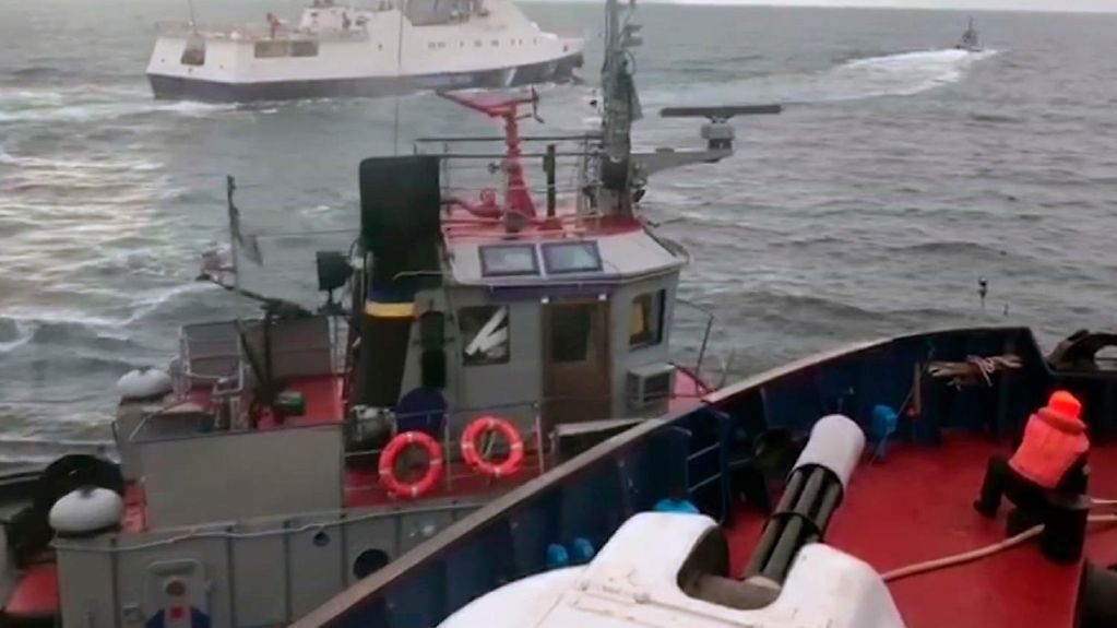 This image taken from a video of the Russian intelligence service shows a Russian coastguard vessel and a Ukrainian tug in the Strait of Kerch.