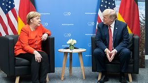Angela Merkel in discussion with Donald Trump