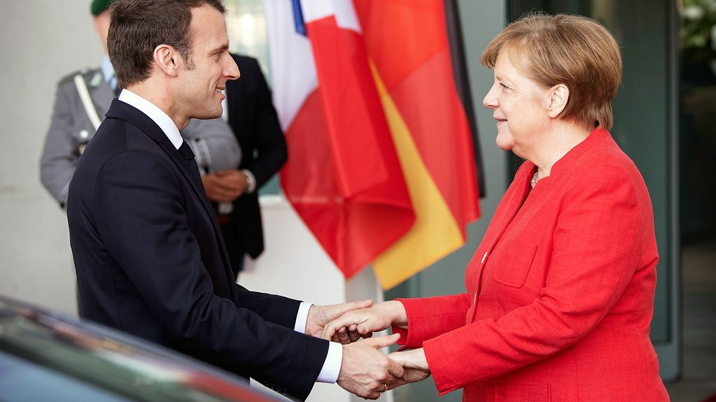 Chancellor Angela Merkel and French President Emmanuel Macron in front of the Federal Chancellery in Berlin