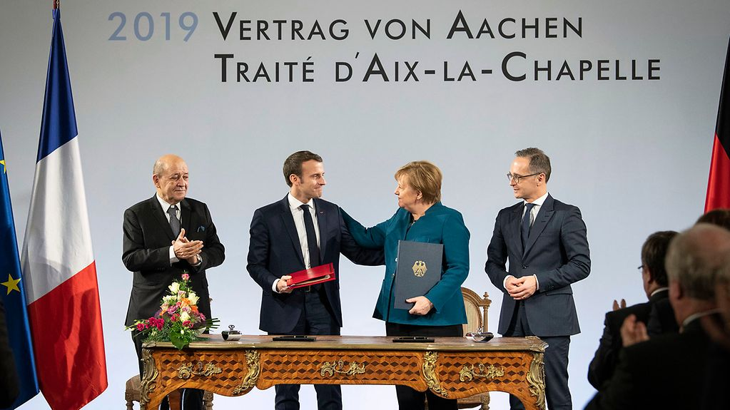 Chancellor Angela Merkel and French President Emmanuel Macron at the ceremony to sign the Treaty of Aachen.