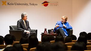 Chancellor Angela Merkel speaks during a discussion with students at Keio University.