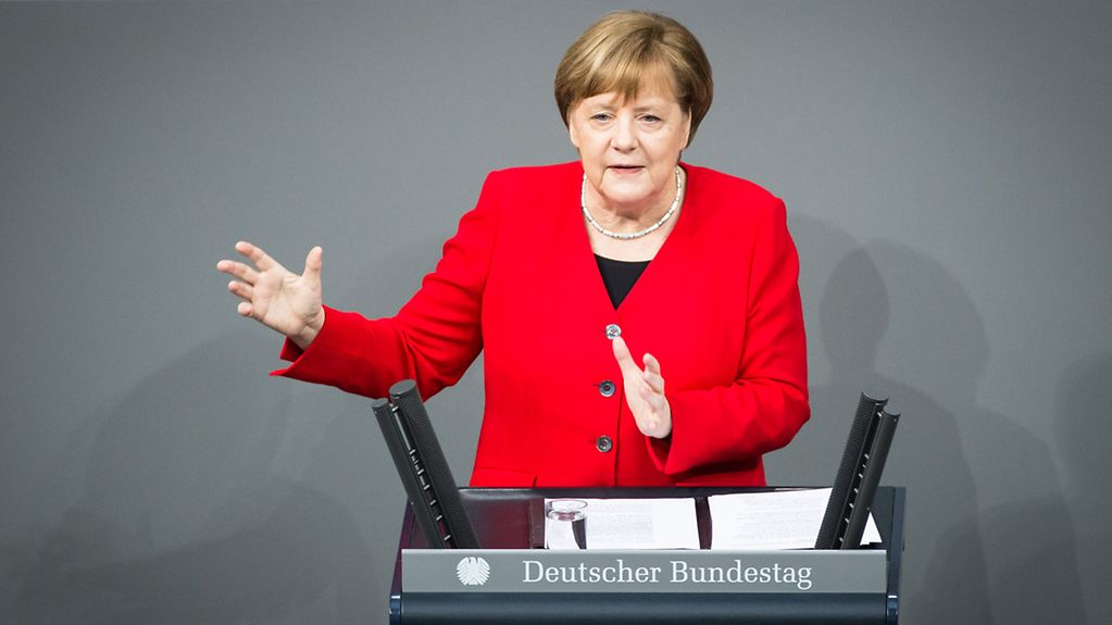 Chancellor Angela Merkel delivers a government statement in the German Bundestag.