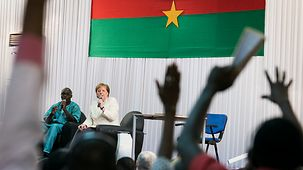 Chancellor Angela Merkel answers students' questions during a visit to the university.