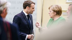 Chancellor Angela Merkel in discussion with French President Emmanuel Macron at the informal meeting of the European Council in Sibiu