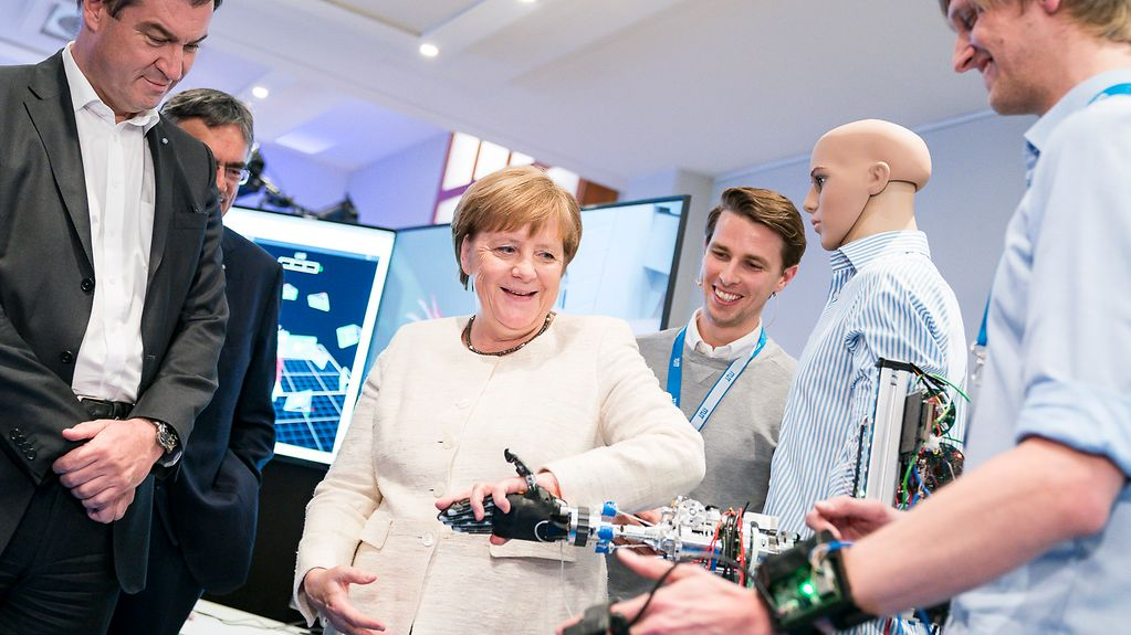 Chancellor Angela Merkel during a guided tour of one of the laboratories of the Munich School of Robotics and Machine Intelligence