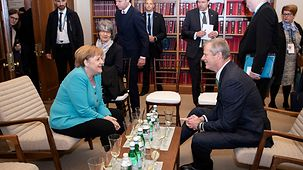 Chancellor Angela Merkel talks with the Governor of Massachusetts, Charles Baker.
