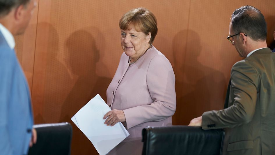 Chancellor Angela Merkel arrives at the Cabinet meeting.
