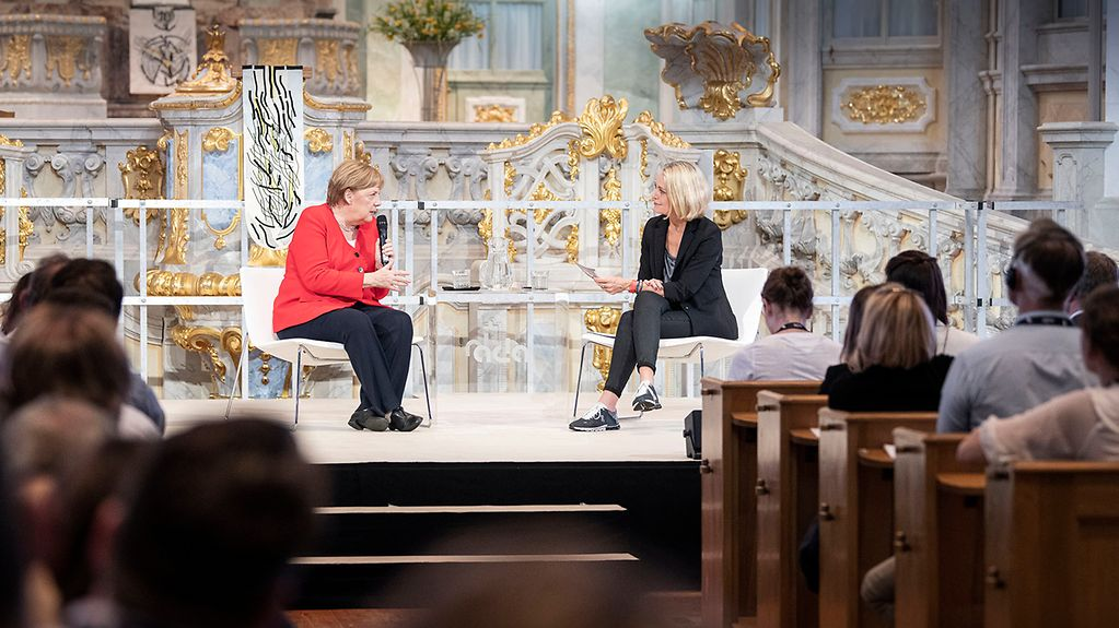 "Chancellor Angela Merkel in discussion with Miriam Meckel during the ""Morals & Machines"" conference in Dresden's Frauenkirche"