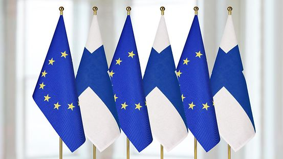 European and Finnish flags flying next to each other.