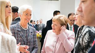 Chancellor Angela Merkel in conversation with Christine Lagarde, Managing Director of the International Monetary Fund (IMF) and other participants