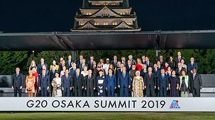 Chancellor Angela Merkel in the family photo at the G20 summit in Osaka