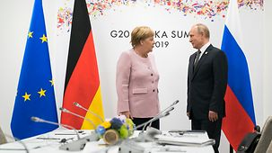 Chancellor Angela Merkel in conversation with Russian President Vladimir Putin