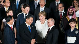 Chancellor Angela Merkel in conversation with Chinese President Xi Jinping and Russian President Vladimir Putin at the G20 summit in Osaka