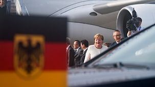 Chancellor Angela Merkel arrives at the airport for the G20 summit.