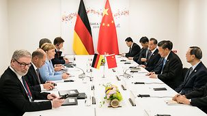 Chancellor Angela Merkel in discussion with Chinese President Xi Jinping at the G20 summit in Osaka