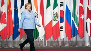 Chancellor Angela Merkel arrives at the G20 summit in Osaka.