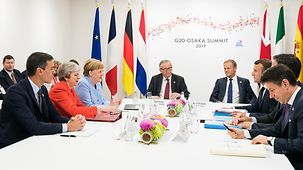 Chancellor Angela Merkel in discussion with EU partners at the G20 summit in Osaka