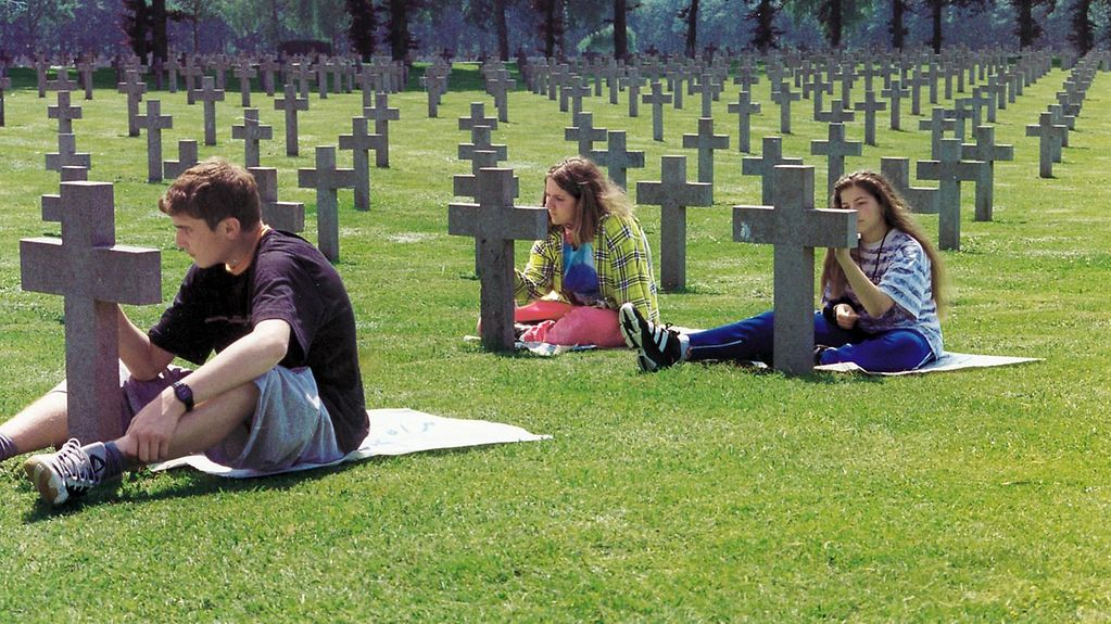 Young people tending gravestones in Ysselsteyn, Netherlands