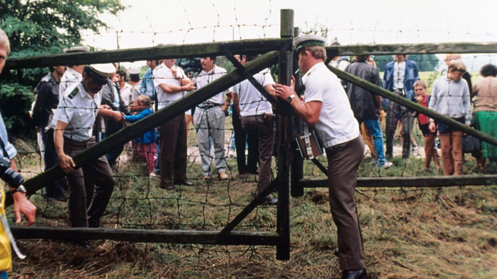 Austrian border guards open a border gate. About 700 East Germans used the Pan-European Picnic at the Hungarian-Austrian border, for which a border gate was symbolically opened, to flee to the West.