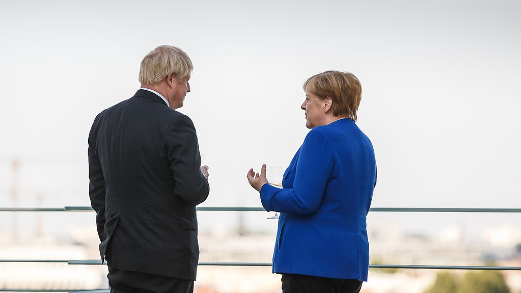 Chancellor Angela Merkel and the new British Prime Minister Boris Johnson on a terrace of the Federal Chancellery