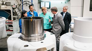 Chancellor Angela Merkel during a visit to the company ZF-Powertrain in China