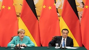Chancellor Angela Merkel and China's Prime Minister Li Keqiang at a joint press conference