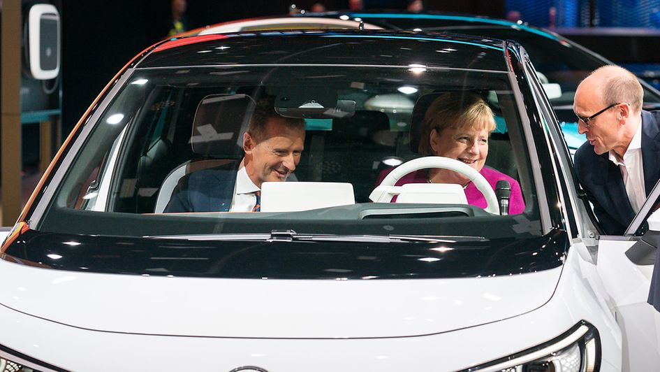 Chancellor Angela Merkel at the Volkswagen stand during her tour of the Frankfurt Motor Show