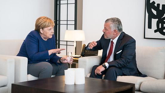 Chancellor Angela Merkel in discussion with King Abdullah II Ibn Al Hussein of Jordan