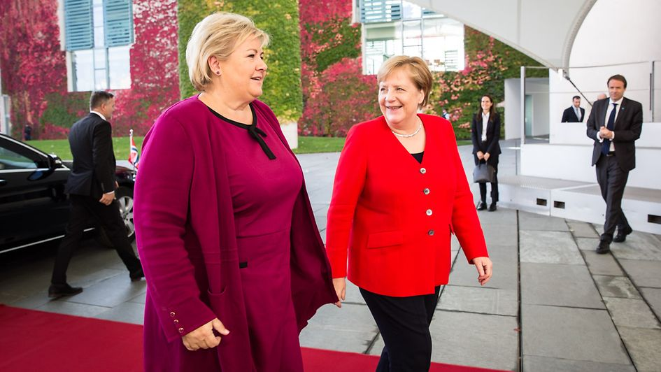 Chancellor Angela Merkel greets Erna Solberg, Norway's Prime Minister, at the Federal Chancellery.