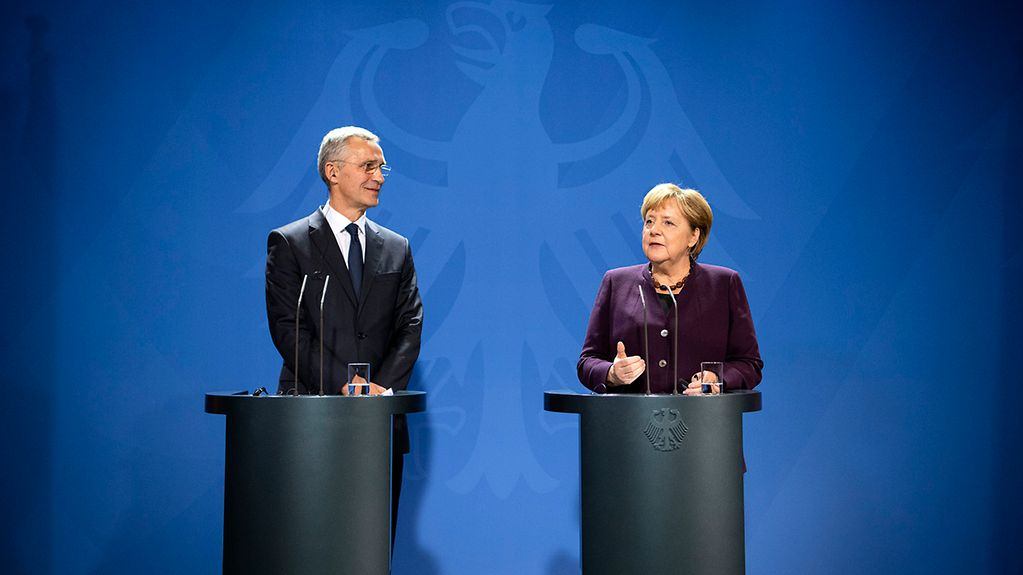 Chancellor Angela Merkel and NATO Secretary General Jens Stoltenberg give a press conference at the Federal Chancellery.