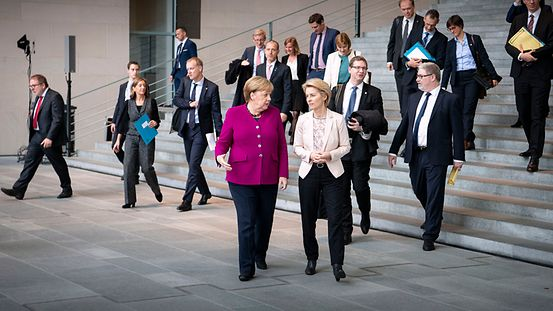 Chancellor Angela Merkel in conversation with Ursula von der Leyen, designated President of the European Commission