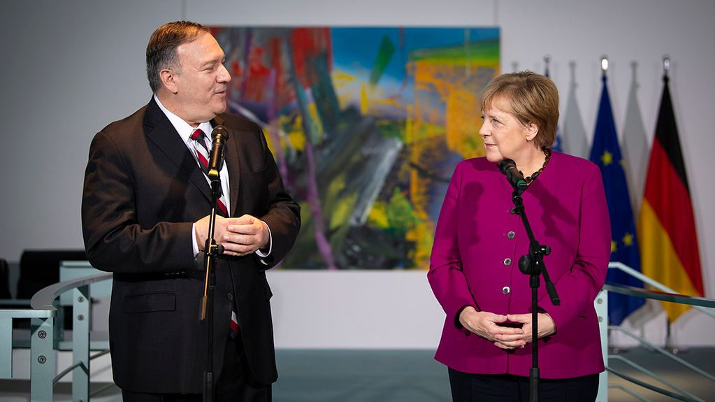 Chancellor Angela Merkel gives a statement to the press with US Secretary of State Mike Pompeo.