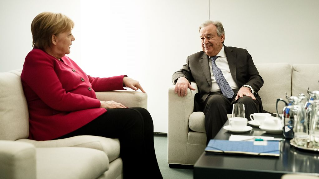 Chancellor Angela Merkel in discussion with UN Secretary-General António Guterres