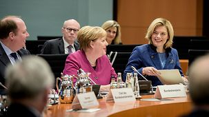 Chancellor Angela Merkel sits next to Julia Klöckner, Federal Minister of Food and Agriculture.