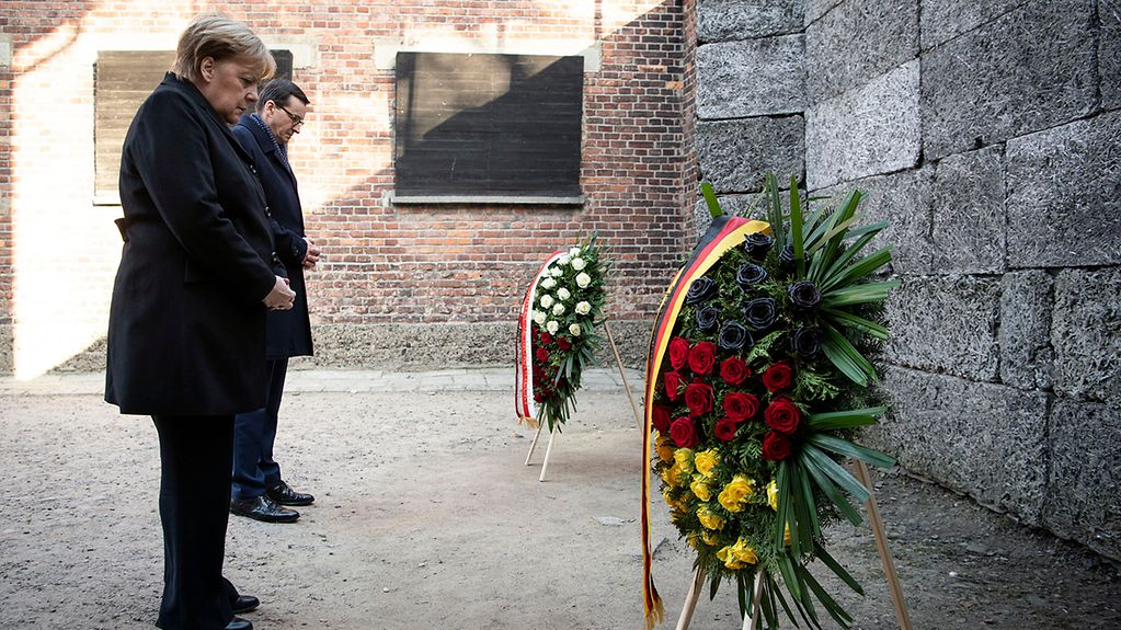 Chancellor Angela Merkel lays a wreath in the former German concentration camp in Auschwitz.