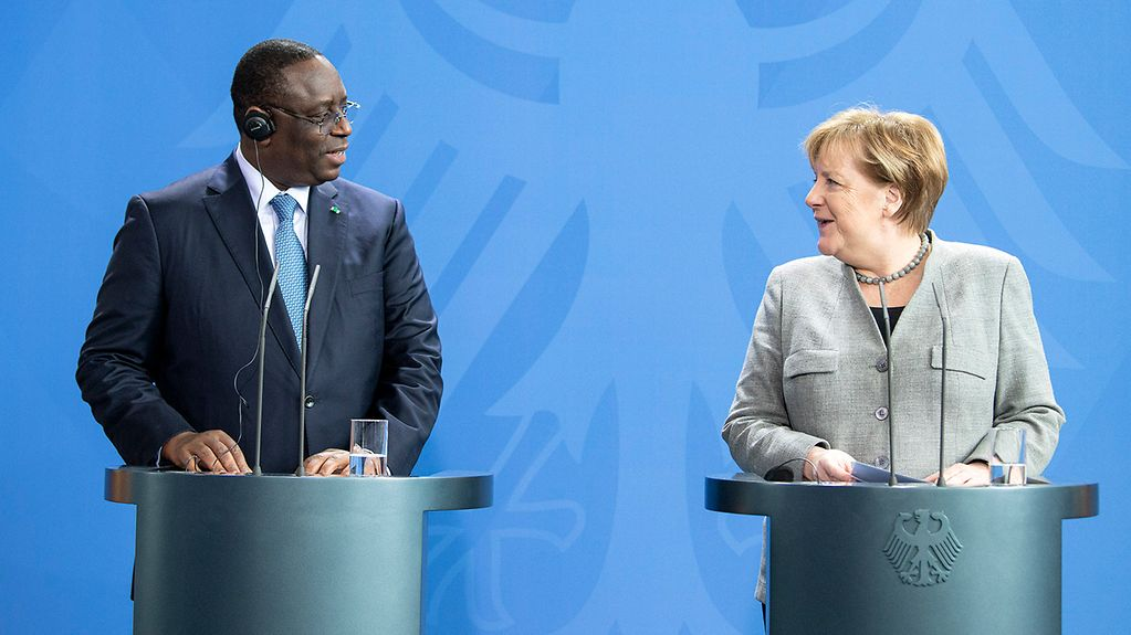 Chancellor Angela Merkel with Macky Sall, Senegal's President, during a press conference