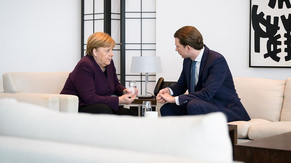 Chancellor Angela Merkel in discussion with Austrian Chancellor Sebastian Kurz