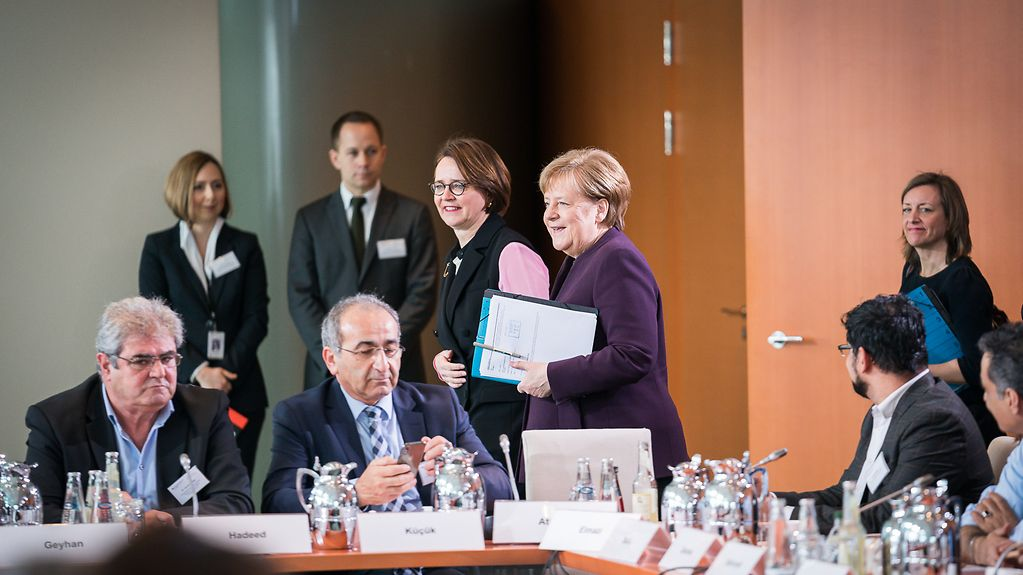 Chancellor Angela Merkel with representatives of migrants' organisations