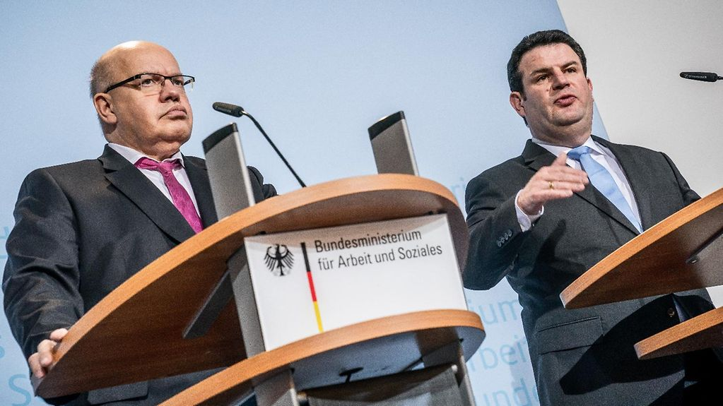 Federal Economic Affairs Minister Peter Altmaier and Federal Labour Minister Hubertus Heil at a press conference