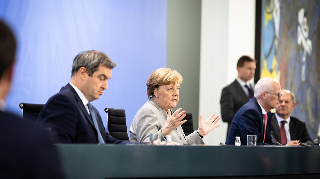 Chancellor Angela Merkel, Bavarian state premier Markus Söder, Hamburg's First Mayor Peter Tschentscher and Federal Finance Minister Olaf Scholz at the press conference to report on the agreement reached by the federal and state governments