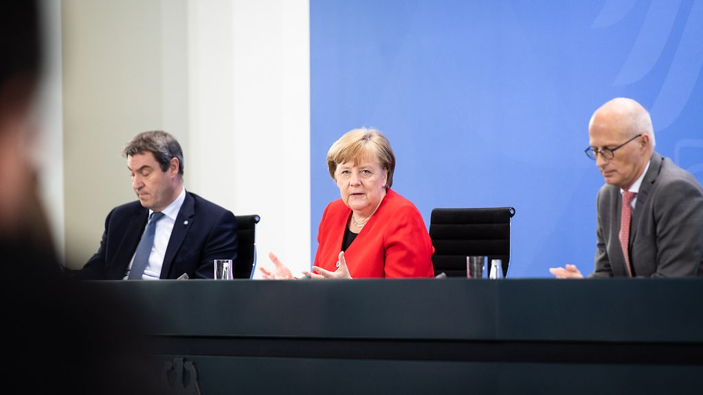 Chancellor Angela Merkel speaks at a press conference following her meeting with the premiers of the federal states.